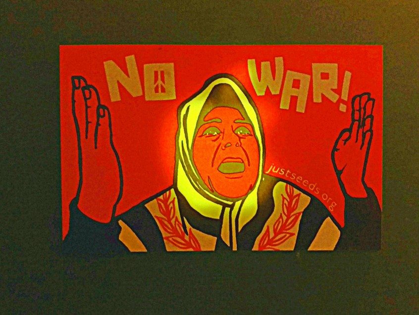 "Woman in burka cries, ""No War!"" Her head appears to glow from the light coming out of the laptop's back, to which she's fixed."